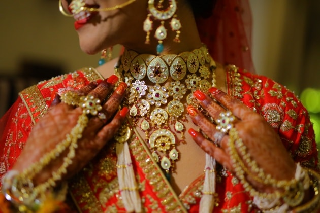 Bride showing Indian wedding jewelry -Wedus